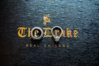 wedding-rings-bands-on-top-of-blue-and-gold-label-for-the-drake-hotel-in-chicago