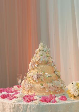 orange-yellow-cake-in-cone-shape-with-flower-design