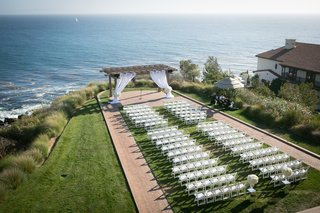 cliffside-ceremony-space-pacific-ocean-white-details-chairs-gazebo-florals