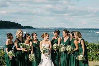 bride-bridesmaids-deep-green-dresses-bouquets-atlantic-ocean-maine-peaks-island-wedding-rustic-squad