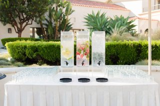 outdoor-wedding-drink-table-water-dispensers-lemon-cucumber-strawberry-mint-ice-water