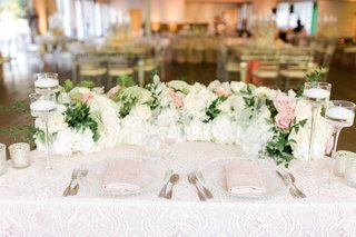 sweetheart-table-with-textured-linen-garland-of-flowers-and-greenery