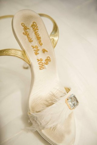 brides-white-sandal-with-gold-straps-and-the-embroidered-couples-names-and-wedding-date