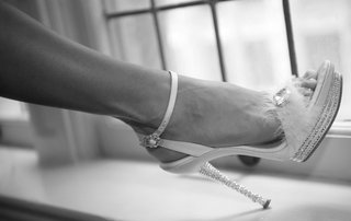 black-and-white-photo-of-brides-heel-decorated-with-crystals