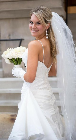 bride-in-gloves-veil-dangle-earrings-and-a-spaghetti-strap-gown-with-an-embroidered-bodice