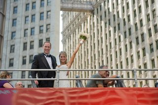 bride-and-groom-take-a-photo-aboard-a-sight-seeing-bus