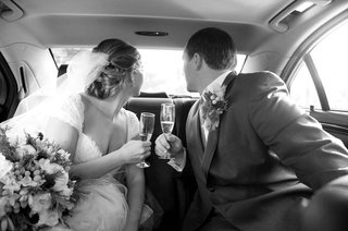 black-and-white-photo-of-bride-and-groom-in-car