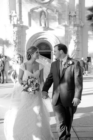 black-and-white-photo-of-bride-and-groom-holding-hands