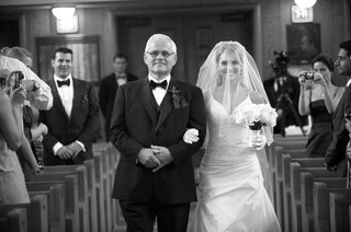 black-and-white-photo-of-father-of-the-bride-walking-her-down-the-aisle