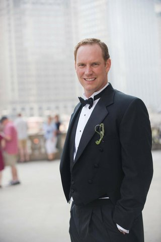 groom-in-a-black-tuxedo-and-bow-tie