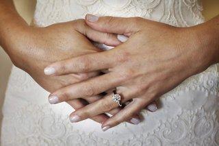 brides-wedding-manicure-with-round-diamond-engagement-ring