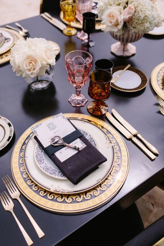 ornate-clear-and-gold-charger-black-table-and-linens-key-on-menu