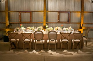tin-barn-wedding-reception-head-table-with-rustic-chairs