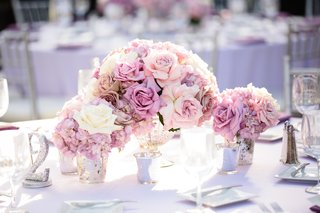 wedding-reception-table-with-lavender-tablecloth-roses-and-hydrangeas-sparkly-table-number