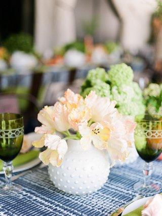 bridal-shower-decor-blue-white-batik-linen-tablecloth-greenery-goblet-colored-glassware-pink-flowers