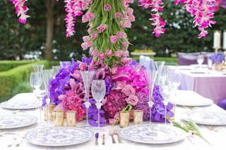 wedding-reception-floral-tree-centerpiece-surrounded-by-purple-fuchsia-vanda-orchids-mauve-roses