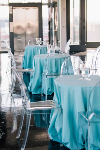 matthew-stafford-rehearsal-dinner-tiffany-blue-small-tables-with-ghost-chairs