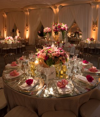 wedding-reception-with-round-table-drapery-low-pink-centerpiece-pink-flower-on-top-of-plates