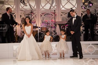 bride-in-a-line-oscar-de-la-renta-wedding-dress-on-dance-floor-with-groom-and-twin-daughters