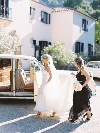 bride-in-trumpet-gown-scalloped-neckline-maid-of-honor-black-a-line-dress-get-into-car-to-ceremony