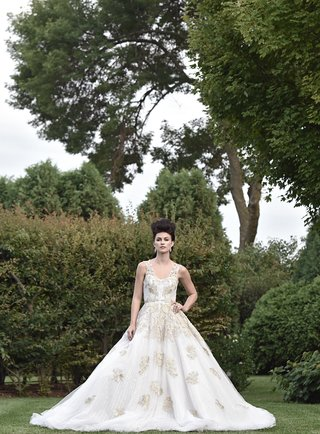 bride-in-ines-di-santo-julia-ball-gown-with-gold-appliques-marie-antoinette-hair