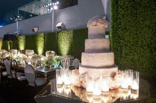 outdoor-rooftop-wedding-white-wedding-cake-round-layers-fresh-peony-flowers-on-top-and-base-candles