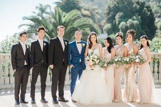 wedding-party-uneven-bridesmaid-groomsman-count-groom-in-navy-blue-suit-bride-in-trumpet-gown