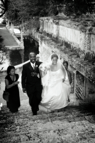 black-and-white-picture-of-father-of-bride-walking-bride-up-stairs