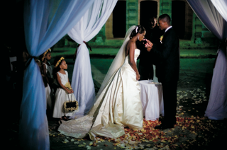 bride-takes-communion-at-nighttime-wedding-ceremony