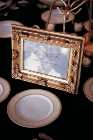 picture-of-bride-and-groom-in-gold-frame-for-wedding-tables