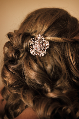 brides-curls-gathered-by-a-rhinestone-barette