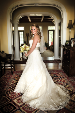 bride-in-a-strapless-vera-wang-gown-with-a-tan-sash-and-bouquet-of-green-flowers