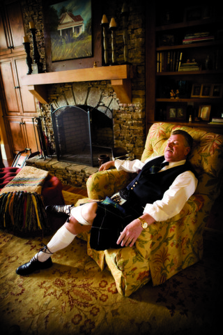 father-of-the-bride-in-a-scottish-kilt-sits-on-a-chair