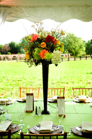 wedding-reception-centerpiece-of-orange-green-white-yellow-and-red-flowers