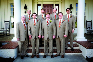 groom-and-groomsmen-in-light-brown-suits-with-striped-ties