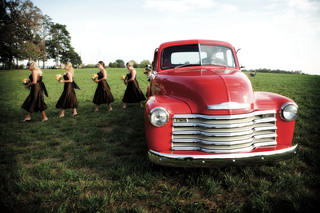 vintage-red-truck-takes-bridesmaids-to-wedding-ceremony