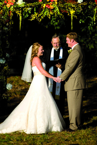 bride-in-a-vera-wang-gown-with-groom-in-a-tan-suit-at-outdoor-ceremony