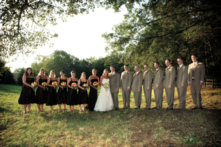 bride-in-a-vera-wang-gown-with-groom-and-bridal-party-on-a-field