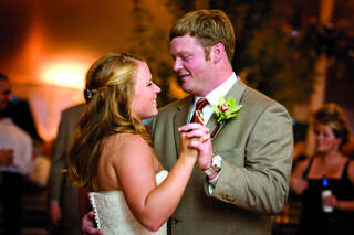 bride-in-a-strapless-vera-wang-gown-dances-with-groom-in-a-tan-suit