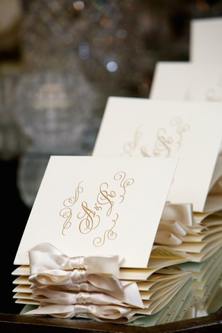 embossed-ceremony-booklets-with-couples-initials