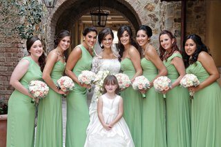 bride-and-flower-girl-with-bridesmaids-at-tuscan-style-venue