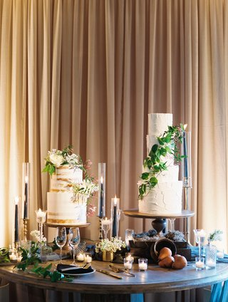 wedding-naked-cake-and-four-layer-white-cake-with-fresh-greenery-candles-on-table