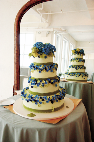 four-layer-cake-with-royal-blue-and-celadon-decorations