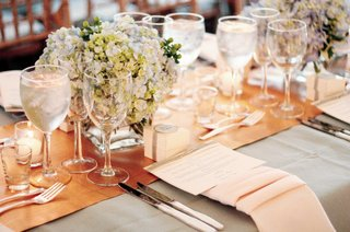 orange-runner-atop-light-grey-tablecloth