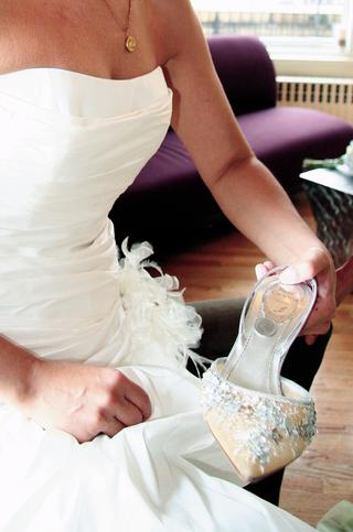 bride-holding-rene-caovilla-wedding-heels