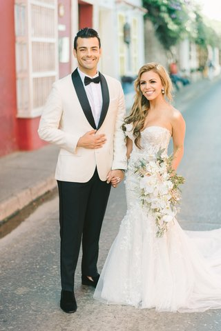 wedding-couple-in-colombia-destination-wedding-groom-white-tuxedo-bride-carines-bridal-atelier-gown