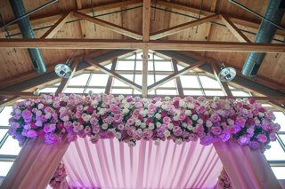 exposed-wood-beams-and-purple-ceremony-altar