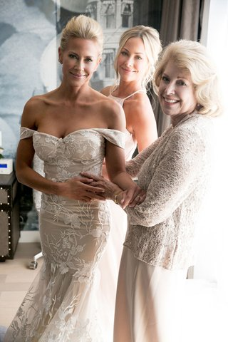 actress-brittany-daniel-in-wedding-suite-off-shoulder-gown-with-twin-sister-cynthia-and-mom