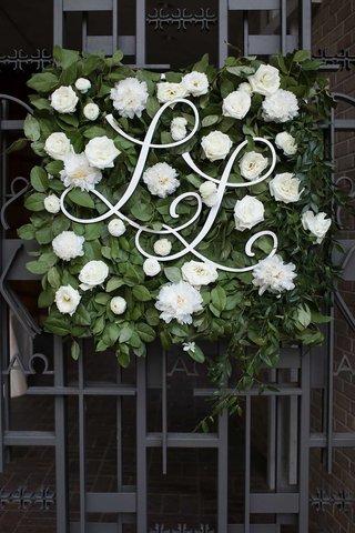 wedding-ceremony-iron-doors-green-square-white-flowers-monogram-cursive-laine-and-layne