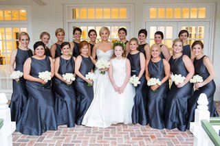 bride-in-strapless-wedding-dress-flower-girl-and-bridesmaids-in-grey-long-silk-gowns